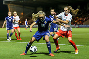 Claire Emslie (#18) of Scotland shields the ball from Noelle Maritz (#5) of Switzerland during the 2019 FIFA Women's World Cup UEFA Qualifier match between Scotland Women and Switzerland at the Simple Digital Arena, St Mirren, Scotland on 30 August 2018.