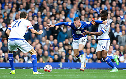 Everton's Ross Barkley battles with John Obi Mikel of Chelsea and Nemanja Matic - Mandatory byline: Matt McNulty/JMP - 07966386802 - 12/09/2015 - FOOTBALL - Goodison Park -Everton,England - Everton v Chelsea - Barclays Premier League