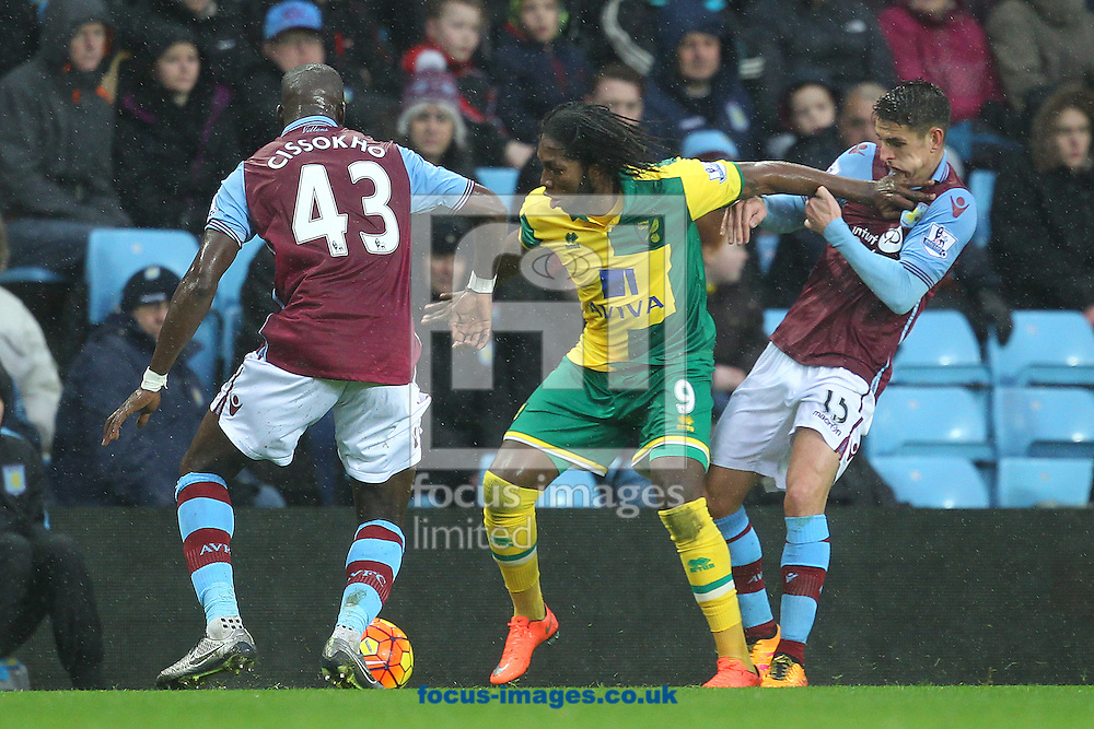 Ashley Westwood of Aston Villa ends up with one of Dieumerci Mbokani of Norwich's fingers in his mouth during the Barclays Premier League match at Villa Park, Birmingham<br /> Picture by Paul Chesterton/Focus Images Ltd +44 7904 640267<br /> 06/02/2016