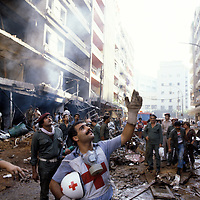 A rescue worker signals upward in the aftermath of an October 1, 1981 car bomb attack in the Fakhani neighborhood of West Beirut, Lebanon. The bomb, killing 86 and wounding 225, was placed outside the offices of the PLO.