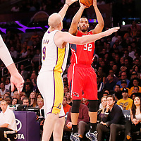 03 November 2013: Atlanta Hawks power forward Mike Scott (32) takes a jumpshot over Los Angeles Lakers center Chris Kaman (9) during the Los Angeles Lakers 105-103 victory over the Atlanta Hawks at the Staples Center, Los Angeles, California, USA.