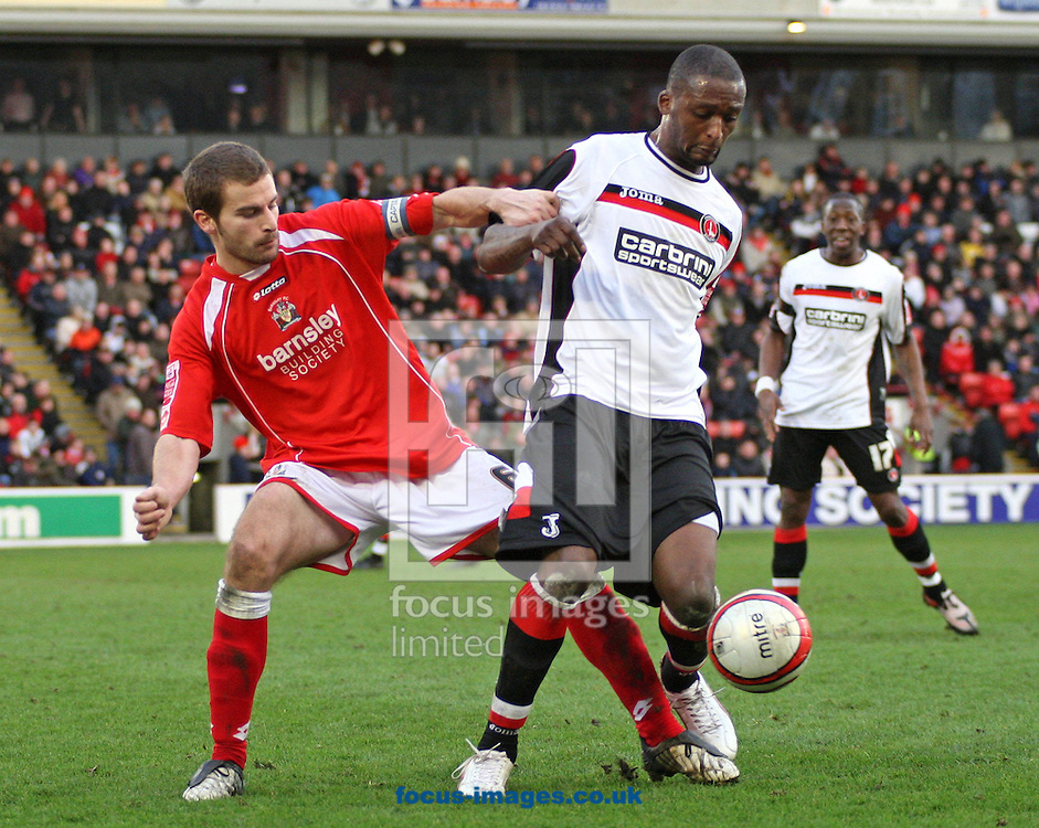 Barnsley - Saturday 21st February 2009 : Trésor Kandol of Charlton Athletic & Stephen Foster of Barnsley in action during the Coca Cola Championship match at Oakwell, Barnsley. (Pic by Steven Price/Focus Images)