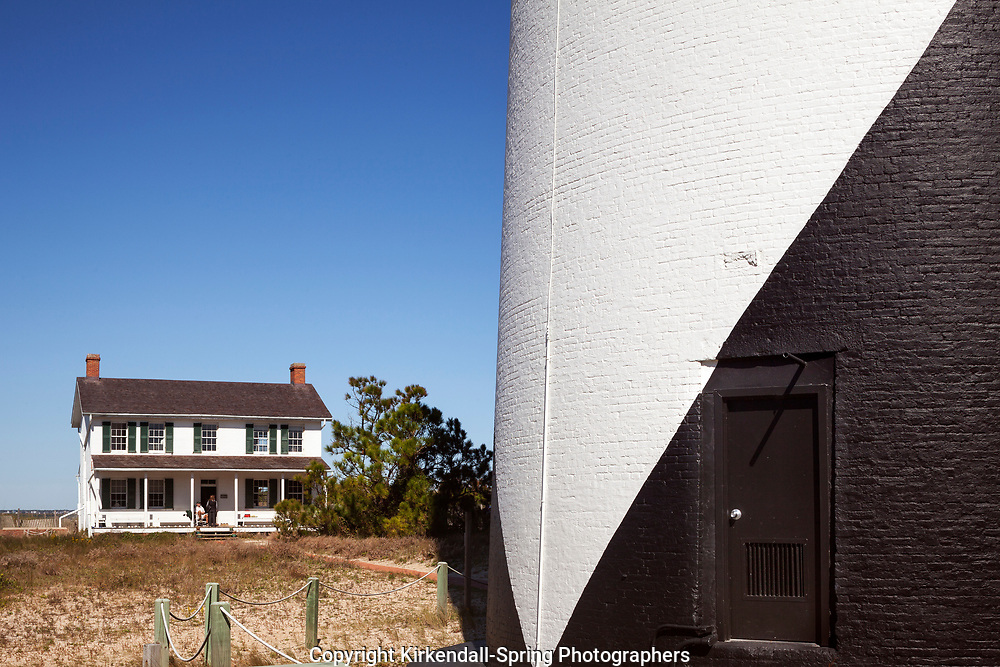 NC00863-00....NORTH CAROLINA -The base of the  Cape Lookout Lighthouse and Lighthouse Keepers House on the South Core Banks in Cape Lookout National Seashore.