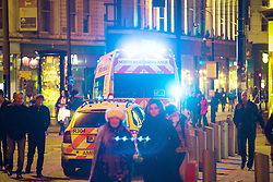 """© Licensed to London News Pictures . 15/12/2017. Manchester, UK. Ambulances in Piccadilly Gardens . Revellers out in Manchester City Centre overnight during """" Mad Friday """" , named for historically being one of the busiest nights of the year for the emergency services in the UK . Photo credit: Joel Goodman/LNP"""