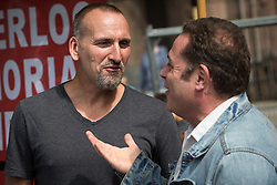 """© Licensed to London News Pictures . 16/08/2015 . Manchester , UK . Actors CHRISTOPHER ECCLESTON and JOHN THOMSON at a """" Peterloo """" memorial at the site of St Peter's Field , where fifteen people were killed during a cavalry charge on a democracy protest , 196 years ago (16th August 1819) . Photo credit : Joel Goodman/LNP"""