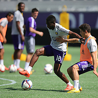 Midfielder Kevin Molino dribbles the ball during the Orlando City Soccer club MLS practice at the Florida Citrus Bowl on Wednesday, March 4, 2015 in Sanford,Florida. The first season for the Lions begins Sunday and over 60,000 tickets have been sold for the home opener, though a league wide player strike may occur prior to the beginning of the scheduled season. (AP Photo/Alex Menendez)