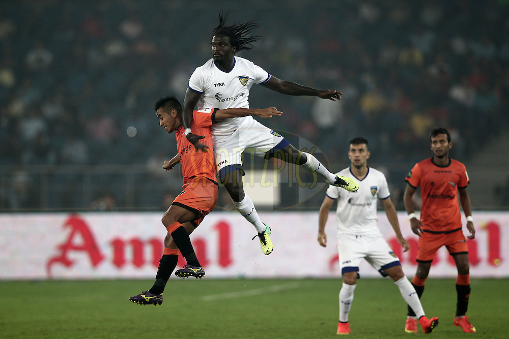 Bernard Mendy of Chennaiyin FC , Syhlo Malsawmtluanga of Delhi Dynamos FC in action during match 12 of the Hero Indian Super League between The Delhi Dynamos FC and Chennaiyin FCheld at the Jawaharlal Nehru Stadium, Delhi, India on the 25th October 2014.<br /> <br /> Photo by:  Deepak Malik/ ISL/ SPORTZPICS