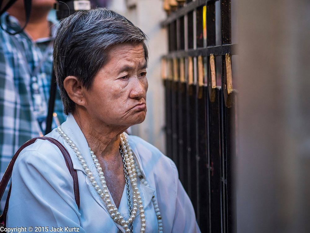 21 AUGUST 2015 - BANGKOK, THAILAND:  A woman prays in front of the Erawan Shrine Friday. The Bangkok Metropolitan Administration (BMA) held a religious ceremony Friday for the Ratchaprasong bomb victims. The ceremony started with a Brahmin blessing at Erawan Shrine, which was the target of a bombing Monday night. After the blessing people went across the street to the plaza in front of Central World mall for an interfaith religious service. Theravada Buddhists, Mahayana Buddhists, Muslims, Sikhs, Hindus, and Christians participated in the service. Life at the shrine, one of the busiest in Bangkok, is returning to normal. Friday the dancers and musicians who perform at the shrine resumed their schedules.        PHOTO BY JACK KURTZ
