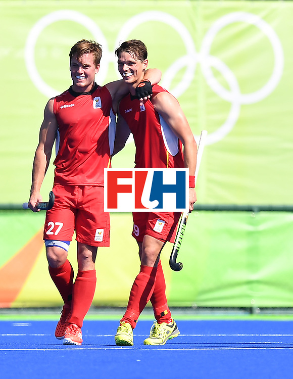 Belgium's Tom Boon (L) and Belgium's Felix Denayer celebrate at the end of the men's quarterfinal field hockey Belgium vs India match of the Rio 2016 Olympics Games at the Olympic Hockey Centre in Rio de Janeiro on August 14, 2016. / AFP / MANAN VATSYAYANA        (Photo credit should read MANAN VATSYAYANA/AFP/Getty Images)