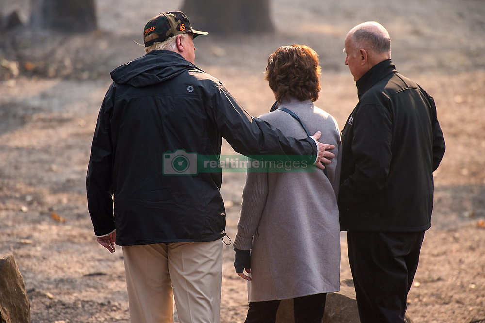 November 17, 2018 - Paradise, California, U.S. - President DONALD TRUMP puts his arm on Paradise MayorJODY JONES as they tour the Skyway Villa Mobile Home and RV Park with Gov. JERRY BROWNduring his visit of the Camp Fire. The Camp Fire in Northern California has become the nation's deadliest wildfire in a century and has killed at least 63 people and left more than 1000 still missing. (Credit Image: © Paul Kitagaki Jr/Sacramento Bee via ZUMA Wire)