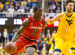 Mar 2, 2016; Morgantown, WV, USA; Texas Tech Red Raiders guard Devaugntah Williams (0) drives to the basket during the first half against the West Virginia Mountaineers at the WVU Coliseum. Mandatory Credit: Ben Queen-USA TODAY Sports