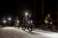 "Bikers head out towards Cobble Mountain trail at the start of the Gunstock Nordic ""Fatbike Fury"" night race on Saturday evening.  (Karen Bobotas/for the Laconia Daily Sun)"