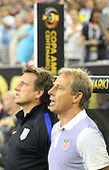 HOUSTON, TEXAS - JUNE 21: United States Manager         Jurgen Klinsmann sings the National Anthem  before the Semifinal match between Argentina and US at NRG Stadium as part of Copa America Centenario US 2016 on June 21, 2016 in Houston, Texas, US. Argentina won 4 to 0. (Photo by Thomas B. Shea/LatinContent/Getty Images)