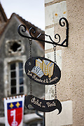 Shop signs, in traditional French village of Angles Sur L'Anglin, Vienne, near Poitiers, France