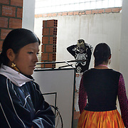 Yolanda La Amorosa paces nervously in the fighters dressing room as she awaits her bout during the 'Titans of the Ring' wrestling group's Sunday performance at El Alto's Multifunctional Centre. Bolivia. The wrestling group includes the fighting Cholitas, a group of Indigenous Female Lucha Libra wrestlers who fight the men as well as each other for just a few dollars appearance money. El Alto, Bolivia, 14th March  2010. Photo Tim Clayton