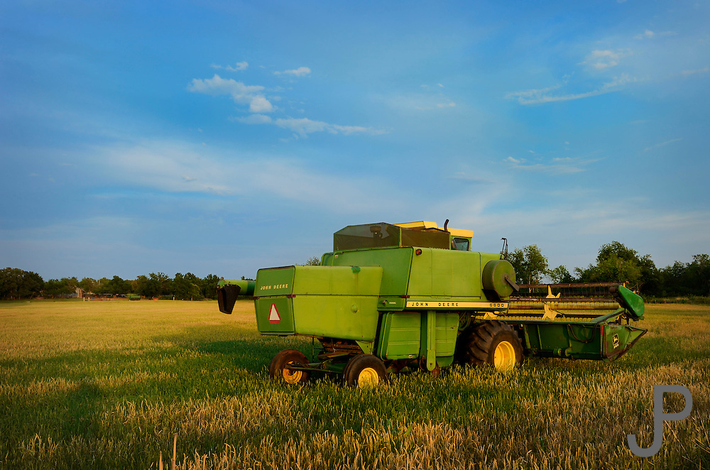 A John Deere combine sits in a wheat field in central Oklahoma near Wellston awaiting the start of harvest.