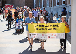 © Licensed to London News Pictures.  29/06/2018; Bristol, UK. Memorial event at Bristol City Hall, honouring Kamil Ahmad and Bijan Ebrahimi: Exploring Disability and Migration. Kamil Ahmad and Bijan Ebrahimi were both disabled men who came to the UK seeking sanctuary. Both were brutally murdered in Bristol. Kamil Ahmad was a disabled Kurdish man who came to Britain seeking sanctuary after having been imprisoned and tortured in Iraq. He was murdered in his supported accommodation in Bristol on 7th July 2016. Bijan Ebrahimi was a disable Iranian refugee, living in Bristol, who was murdered at his home on 14 July 2013. Two men, police beat manager PC Kevin Duffy, and police community support officer Andrew Passmore, were both jailed over how they dealt with Ebrahimi after being found guilty of misconduct in a public office. They and two other constables, Leanne Winter, 38, and Helen Harris, 40, who arrested Ebrahimi, have been dismissed from the force. Bristol Mayor Marvin Rees said sorry to the families of both men at the memorial event at Bristol City Hall, part of Bristol Refugee Festival, where a mural in memory of Kamil Ahmad was unveiled. Afterwards a march in support of disabled refugees was held in the centre of Bristol. <br /> Photo credit: Simon Chapman/LNP
