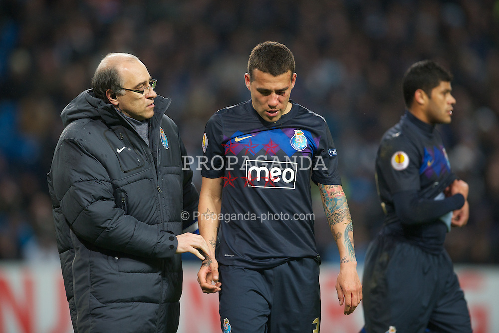 MANCHESTER, ENGLAND - Wednesday, February 22, 2012: FC Porto's Nicolas Otamendi is treated after being kicked in the face during the UEFA Europa League Round of 32 2nd Leg match against Manchester City at City of Manchester Stadium. (Pic by David Rawcliffe/Propaganda)