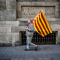 Barcelona, Spain - 8 October 2017: A man holds a Spanish flag during the Pro unity rally against Catalonian Independence