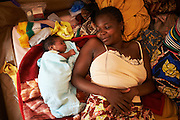 "Central African Republic /  Nailonadege, 35 years old lies with her baby son Francois Hollande within the maternity ward of the MSF clinic at the international airport in Bangui on December 16, 2013. She delivered her baby the night the French President flew into Bangui to meet with officials and discuss the crisis in the country. ""My back is hurting after the delivery. I hope the French can do something to help us out of this situation.""  8 babies are born in the maternity ward per day. The clinic has hundreds of patients flooding in every day with patients suffering from malaria, respiratory infections, gun shot and burn wounds and also mothers in labour. With the main hospital closed due to insecurity many people are being treated at this clinic within the IDP camp. l There are 35,000 IDPs sheltering here having fled violence between anti-Balaka fighters and Seleka rebels with their parents and siblings a week before. On the morning of Thursday 5th, December Christian anti-balika militants entered the city and attacked Seleka rebels. Over the days that followed hundreds of people were killed. The Seleka made up of a muslim majority with many of the rebels originating from northern Central African Republic, Sudan and Chad brought to power a new president Michel Djotodia, a former Seleka leader in a March 24, 2013 coup.  The political establishment has failed to control the armed group that has wreaked havoc, including murdering, looting and burning of villages on the civilian population with mass displacements resulting.UNHCR / S. Phelps / December 2013"