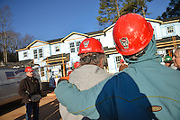 NC State employees wait for their work assignments on the Build-A-Block Habitat for Humanity project.