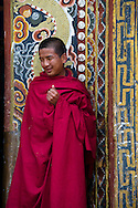 "Paro, Bhutan. A monk in the dzong Rinpung, built in 1646. The name means a ""fortress that sits on a heap of jewels""."