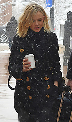 EXCLUSIVE: Marcus Mumford was left with the luggage pulling it through the streets of Park City, Utah as wife Carey Mulligan carried a coffee. The married couple braved the snow at The Sundance Film Festival where Carey is promoting her upcoming movie Wildlife (2018). 20 Jan 2018 Pictured: Carey Mulligan. Photo credit: Atlantic Images / MEGA TheMegaAgency.com +1 888 505 6342