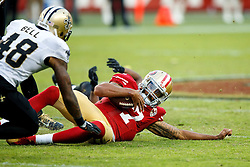 SANTA CLARA, CA - NOVEMBER 06: Quarterback Colin Kaepernick #7 of the San Francisco 49ers slides in front of free safety Vonn Bell #48 of the New Orleans Saints during the fourth quarter at Levi's Stadium on November 6, 2016 in Santa Clara, California. The New Orleans Saints defeated the San Francisco 49ers 41-23. (Photo by Jason O. Watson/Getty Images) *** Local Caption *** Colin Kaepernick; Vonn Bell