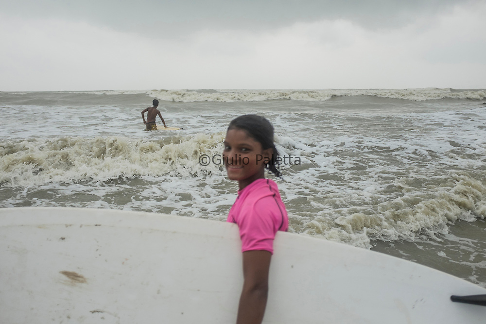 The girls having fun while surfing at Cox's Bazar's beach