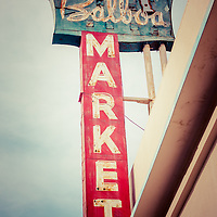 Photo of Balboa Market sign in Newport Beach on Balboa Peninsula. Located at 608 E. Balboa Blvd., Newport Beach, CA 92661, the store was built in 1938 and served as a grocery store for the small community of Balboa California. Balboa Market was torn down in October 2010 and the land is now used for a parking lot. Newport Beach is a wealthy beach community along the Pacific Ocean in Orange County Southern California.