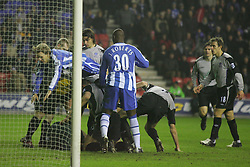 WIGAN, ENGLAND - TUESDAY, JANUARY 31st, 2006: Wigan Athletic's Jimmy Bullard jumps over the crowed of players during the Premiership match at the JJB Stadium. (Pic by David Rawcliffe/Propaganda)