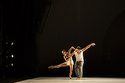 """Celine Cassone and Alexander Hille of Les Ballets Jazz de Montréal dance in Benjamin Millepied's """"Closer"""". The start of the performance at the outdoor venue was delayed by 30 minutes because of rain."""