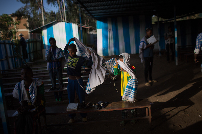 Members of the Falash Mura Jewish Ethiopian community attend morning prayer services  in the ha Tikva synagogue in Gonder, Ethiopia during the Jewish holiday of Passover. There are about 6000 Jewish Falash Mura in Gonder, waiting to immigrate to Israel. April 22, 2016. Photo by Miriam Alster/FLASH90
