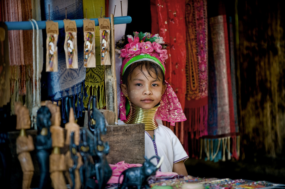 A young hill tribe vendor in Chiang Mai, Thailand