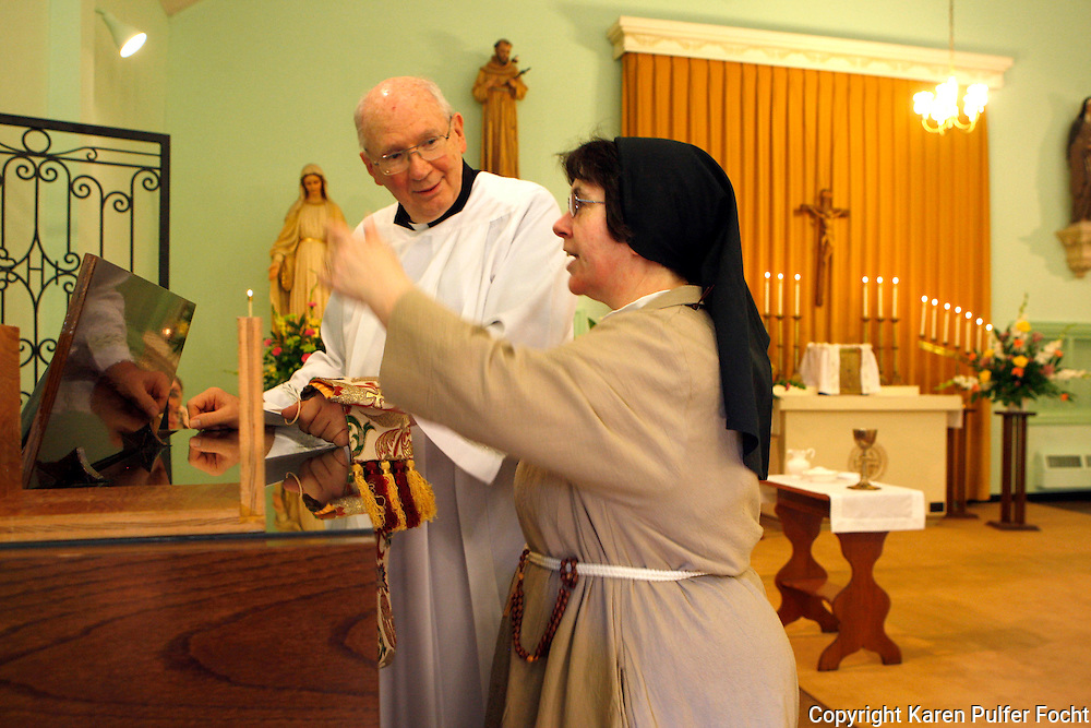 Sister Anthony, a cloistered Poor Clare Nun from Memphis, Tennessee, celebrates 25 years as a nun. The number of Poor Clare nuns in Memphis is dwindling. With James Father Pugh. They are a community of Catholic women who have chosen to embrace the way of life proposed by a young Italian girl in Assisi over 800 years ago.