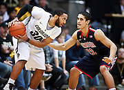 SHOT 1/21/12 6:38:44 PM - Colorado's Carlon Brown #30 looks to drive on Arizona's Nick Johnson #13 during their PAC 12 regular season men's basketball game at the Coors Events Center in Boulder, Co. Colorado won the game 64-63..(Photo by Marc Piscotty / © 2012)