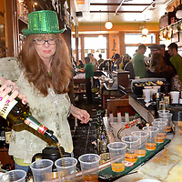 Geraldine Gilliland, owner of Finn McCool's Irish Pup, makes Irish Coffee during St. Patricks Day on Saturday, March 17, 2012..