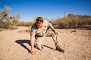 "03 MAY 2012 - VEKOL VALLEY, RURAL PINAL COUNTY, AZ:    Jon Young (CQ Jon), the BLM  Chief Ranger for Arizona, cuts for sign of smugglers during a foot patrol on Bureau of Land Management land south of Interstate 8 and west of Casa Grande in rural Pinal County. The area has been a hotbed of illegal immigrant and drug smuggling for years. The BLM has undertaken a series of ""surges"" in the area, increasing their law enforcement patrols and partnering with Border Patrol and Pinal County Sheriff's Department officers to reduce criminal activity in the area.       PHOTO BY JACK KURTZ"