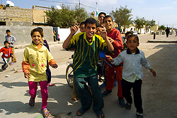 Local Iraqi Children rush to ask for their photograph taken during a patrol with British Forces in the Basra Area of Iraq March 2005