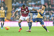Aston Villa's Leandro Bacuna challenges for the ball with Arsenal's Alex Oxlade-Chamberlain during the Barclays Premier League match between Aston Villa and Arsenal at Villa Park, Birmingham, England on 13 December 2015. Photo by Shane Healey.