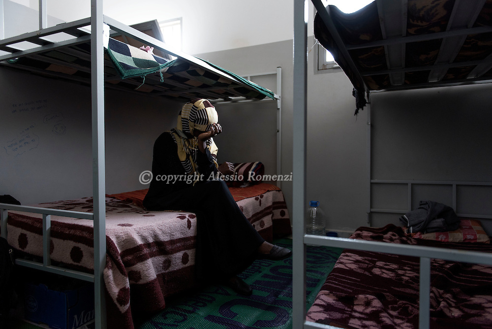 Libya, Misurata: Tecle 40yo an Eritrean woman who claims to have being used as sex slaves by ISIS member in Sirte is seen inside her cell at the Libyan airforce compound in Misurata. Alessio Romenzi
