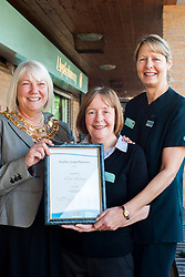 Lloyds Pharmacy Stocksbridge has achieved the status of 'Healthy Living Pharmacy'. A special accreditation for offering high levels of health screening  and advice to the local community. Pharmacy Manager Jackie Walter and Vikki Sheppard Lloyds Stocksbridges first Healthy Living Champion receiving the award from Mayor of Stocksbridge Susie Abrahams, ..04 October 2012.Image © Paul David Drabble