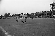 21/08/1966<br /> 08/21/1966<br /> 21 August 1966<br /> St. Patrick's Athletic v Waterford at Richmond Park, Dublin. Waterford's O'Neill breaks past a Pat's back as Whelan (St. Pat's) runs in to help.