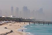 Jumeirah, Burj Al Arab, the World's most luxurious hotel. View over the beach and Dubai Marina construction site.
