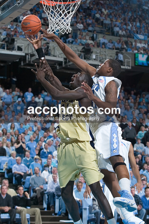 20 January 2007: North Carolina Tar Heels forward Deon Thompson (21) tips the ball away from Yellow Jackets forward Mouhammad Faye (11) during a 77-61 Georgia Tech Yellow Jackets loss to the North Carolina Tar Heels, in the Dean E. Smith Center in Chapel Hill, NC.