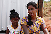 Twenty-five-year-old Thayaparan and her six-year-old daughter Mutalakshmi sit on the step of their new toilet in the village of Kalvallam, northern Sri Lanka. The toilet has been built by the UN's Office for Project Services (UNOPS), with funding from UKaid.<br /> <br /> &quot;The new toilet is amazing. We didn't have anything like this before. Now it means that my daughter won't get sick. Even though we have very little, now we have returned to a new life&quot;, says Thayaparan.<br /> <br /> &quot;Our life has been very hard, but now we feel reborn&quot;.<br /> <br /> To find out more about how DFID is helping in Sri Lanka, please visit www.dfid.gov.uk/srilanka ( http://www.dfid.gov.uk/srilanka ) <br /> <br /> Image: Russell Watkins / Department for International Development