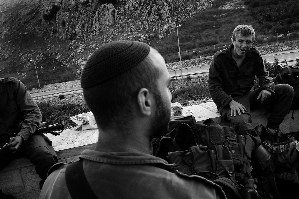 Soldiers rest the morning after a cross-border operation, Metulla, northern Israel. Aug 2006