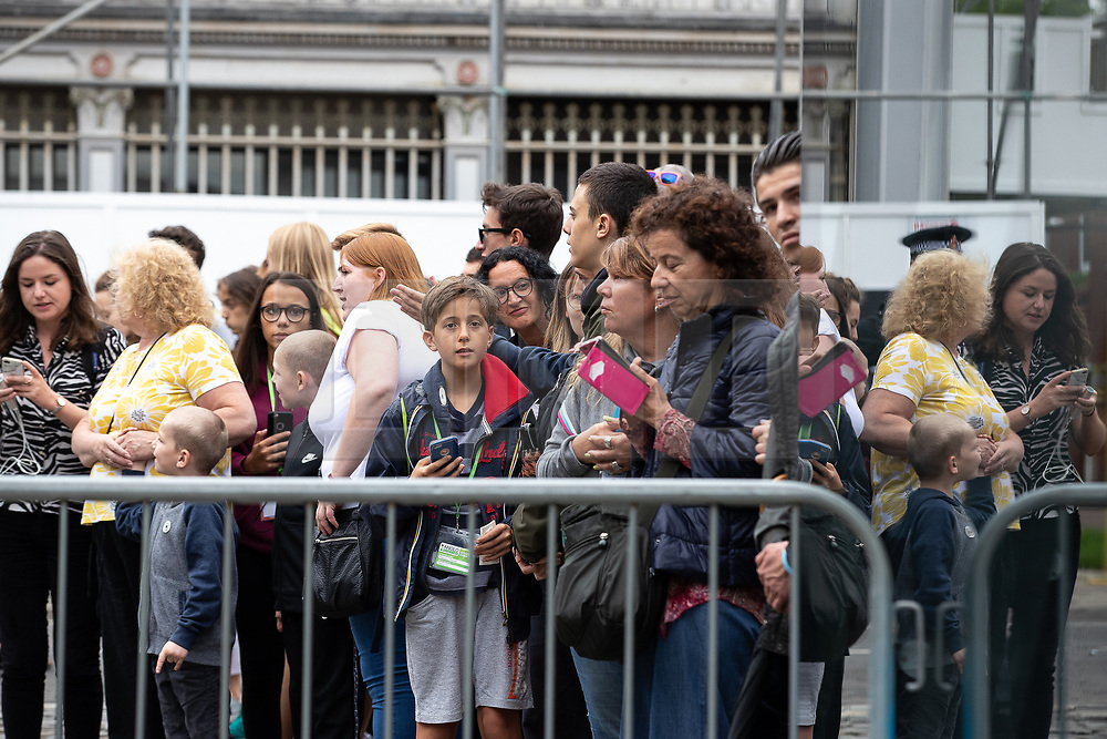 © Licensed to London News Pictures. 27/07/2019. Manchester, UK. A crowd of onlookers gather to catch a glimpse of British Prime Minister Boris Johnson leaving the Science and Industry Museum after a speech in Manchester City Centre . Johnson was due to re-announce the HS3 rail link between Manchester and Leeds . Photo credit: Joel Goodman/LNP