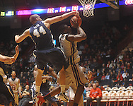 "Mississippi forward Reginald Buckner (2)  is fouled by East Tennessee State's J.C. Ward (44) at the C.M. ""Tad"" Smith Coliseum in Oxford, Miss. on Saturday, December 18, 2010. Ole Miss won 71-50."