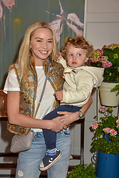 Noelle Reno and her son Xander Perks at the Belmond Cadogan Hotel Grand Opening, Sloane Street, London England. 16 May 2019. <br /> <br /> ***For fees please contact us prior to publication***
